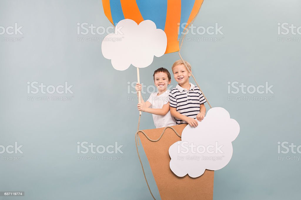 Friends flying in balloon stock photo