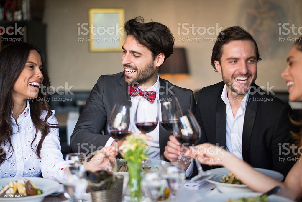 Friends gathered at restaurant stock photo
