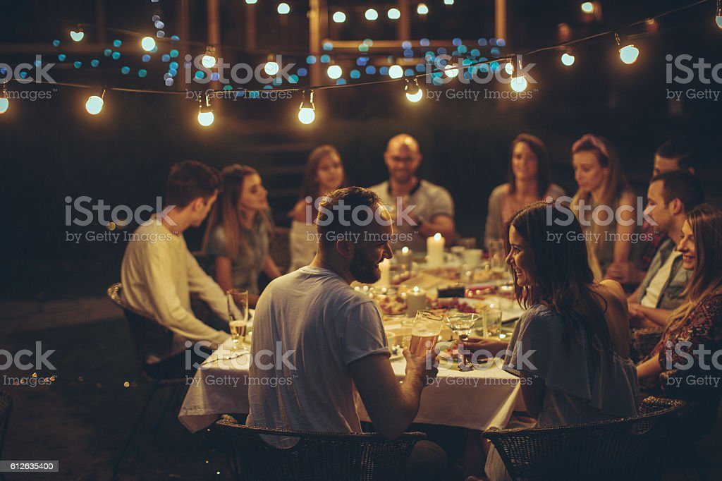 Friends gathered over dinner stock photo