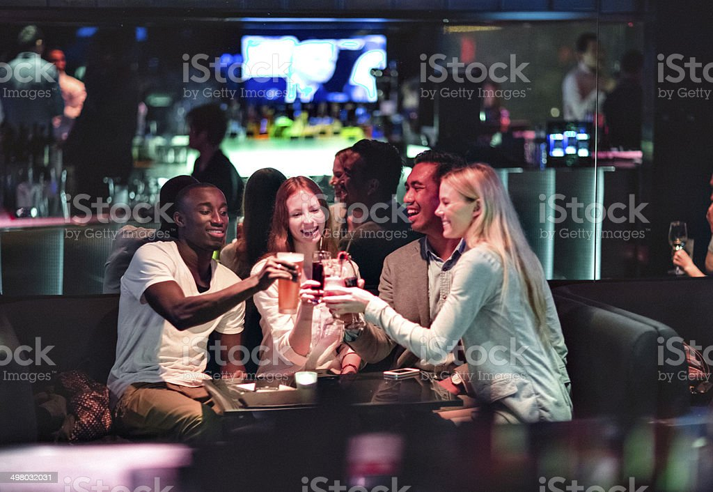 Friends gathering in the club stock photo