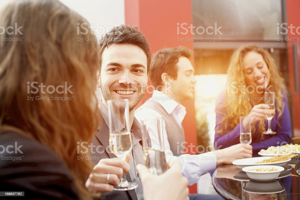 friends give toast over Italian aperitif royalty-free stock photo