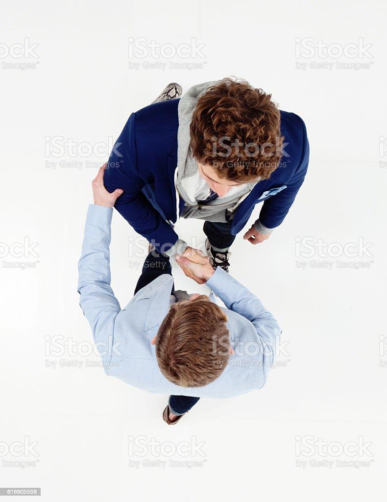 Friends giving handshake stock photo