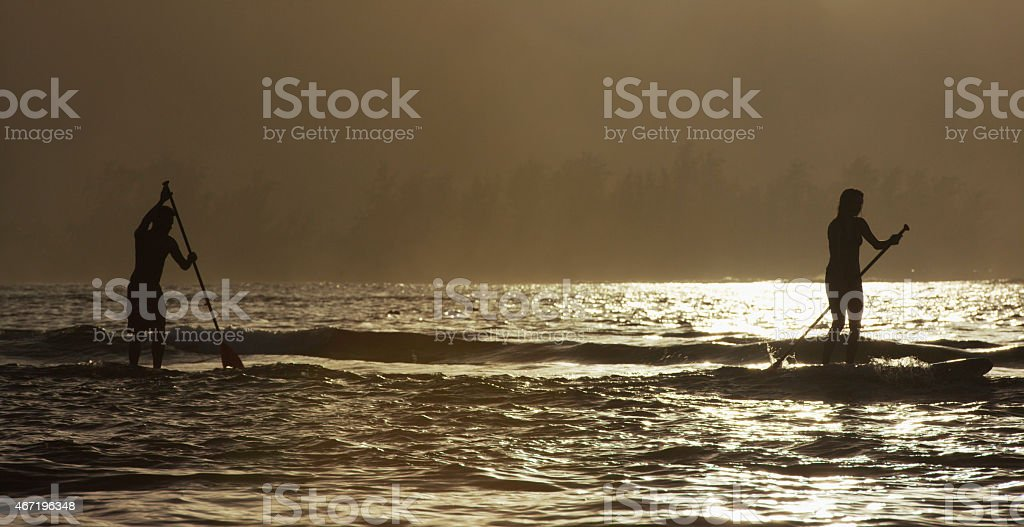 Friends going for one more surf stock photo
