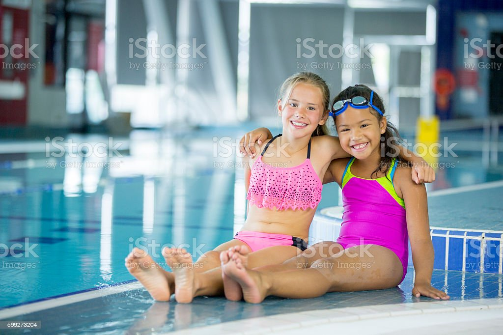Friends Going Swimming at the Pool stock photo
