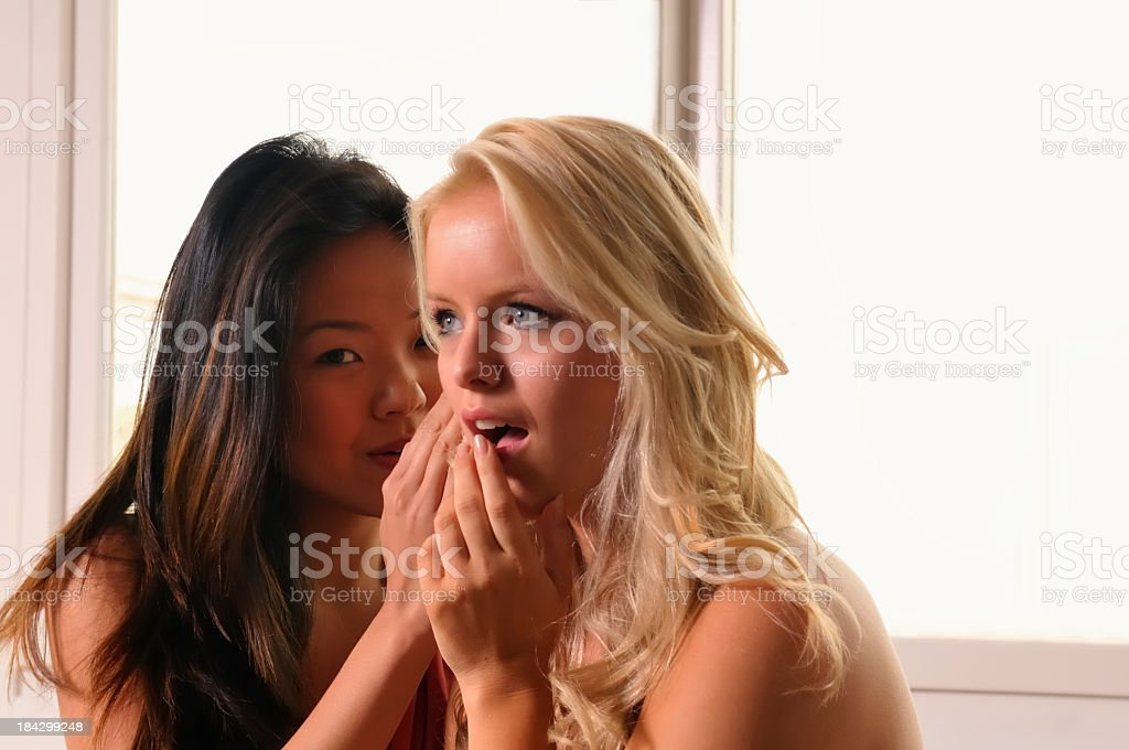 Friends gossiping stock photo