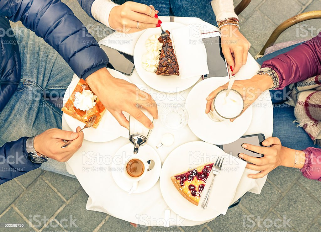 Friends group with cakes coffee and milk at bar restaurant stock photo