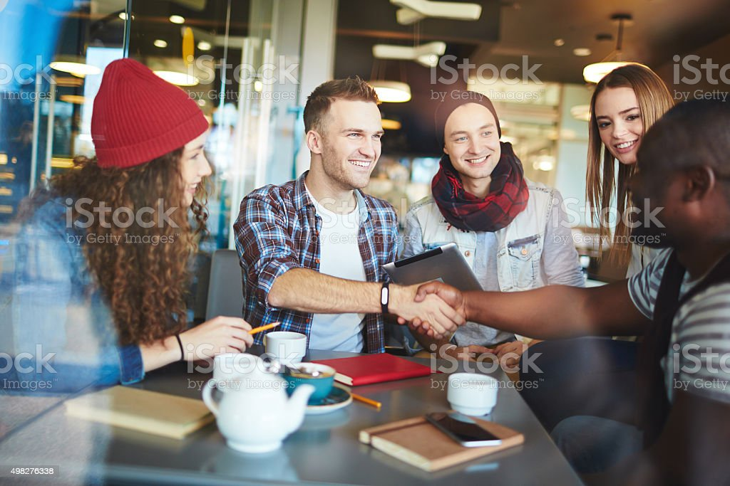 Friends handshaking stock photo