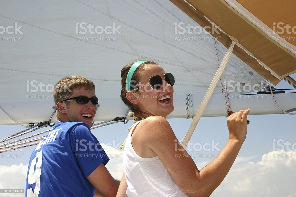 Friends hanging on a sailboat on s sunny day royalty-free stock photo