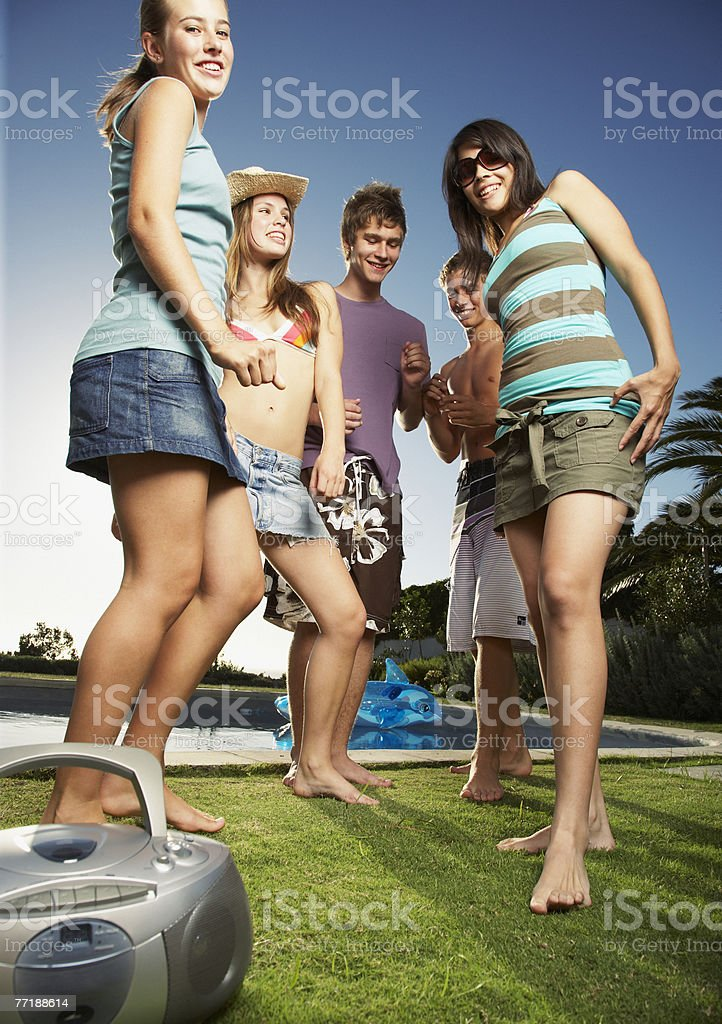 Friends hanging out by a pool royalty-free stock photo