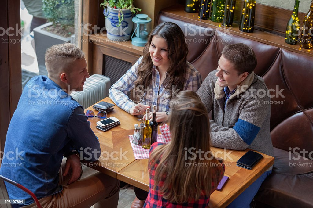 Friends hanging out in cafe stock photo