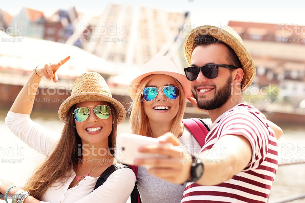 Friends hanging out in the city and taking selfie stock photo