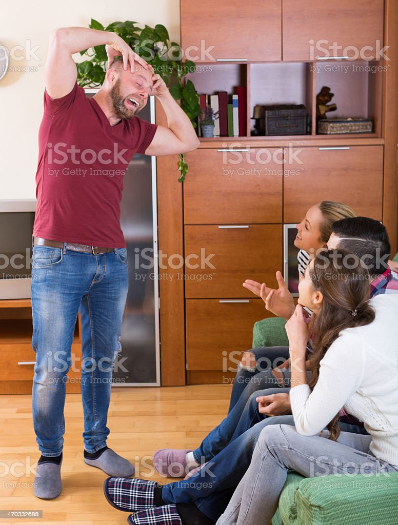 friends hanging out with beer and jokes stock photo