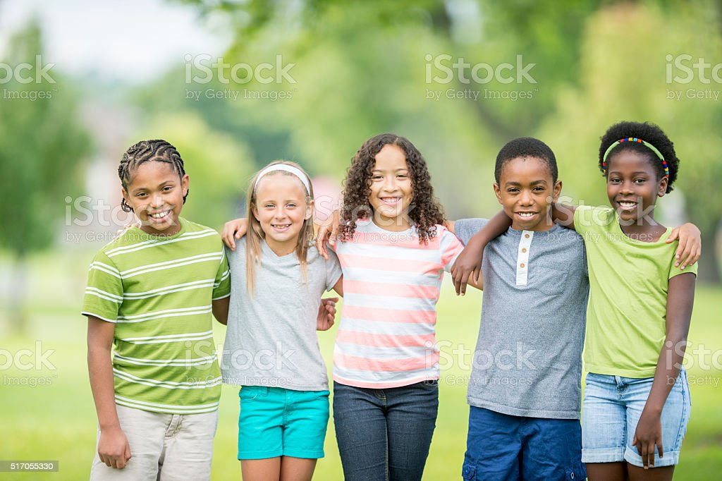 Friends Happily Standing Together stock photo