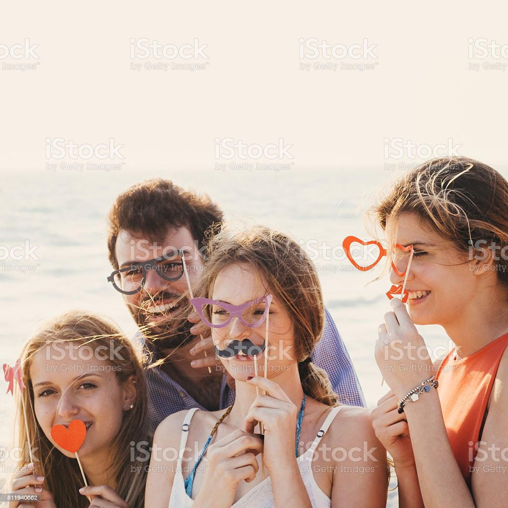 Friends Have A Party On The Beach stock photo