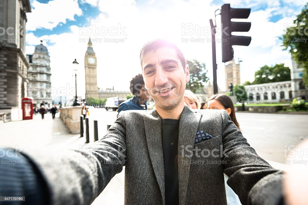 Friends have fun in London and take a selfie stock photo