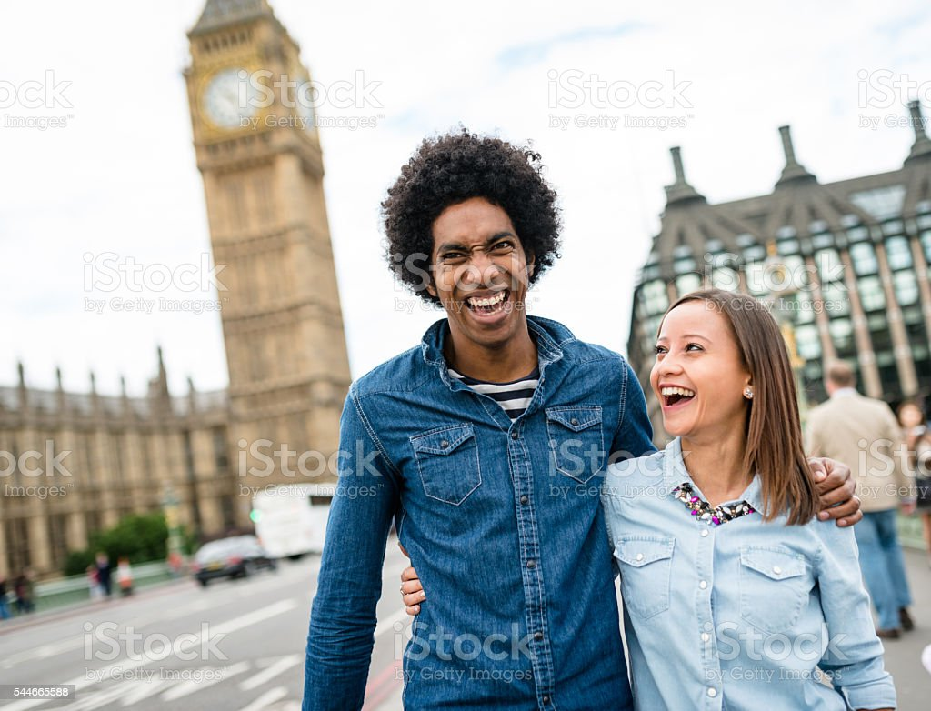 Friends have fun in London at the big ben stock photo
