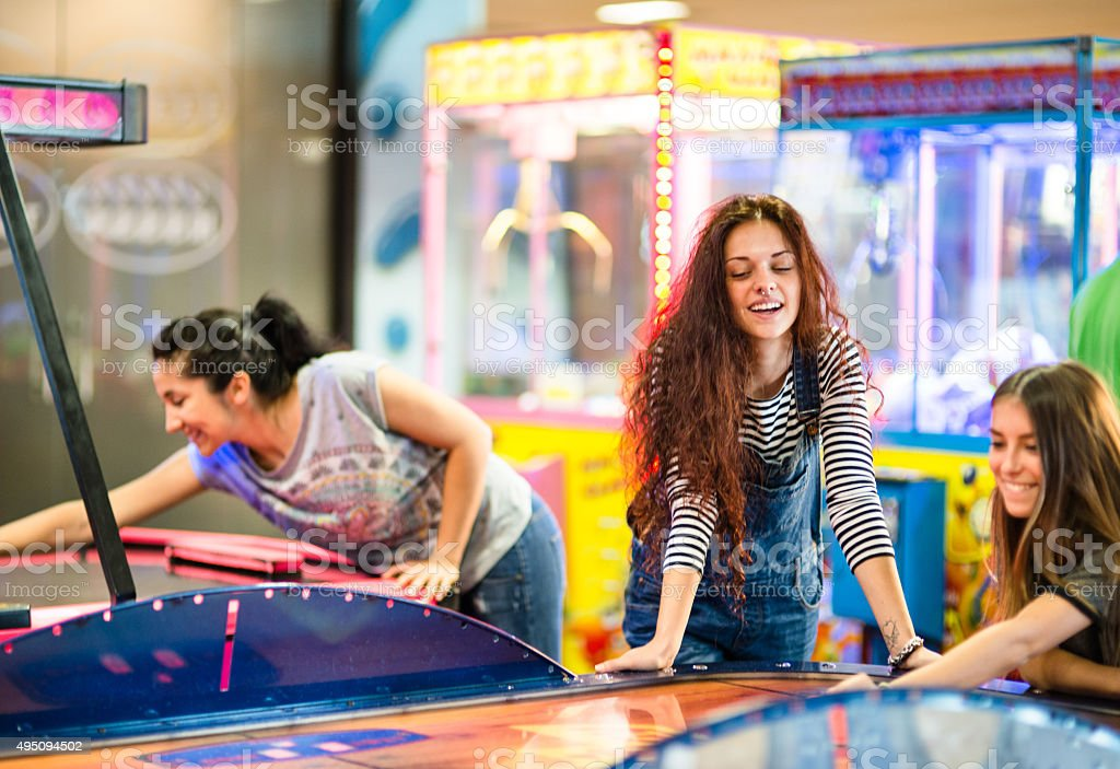 Friends have fun on the game room stock photo