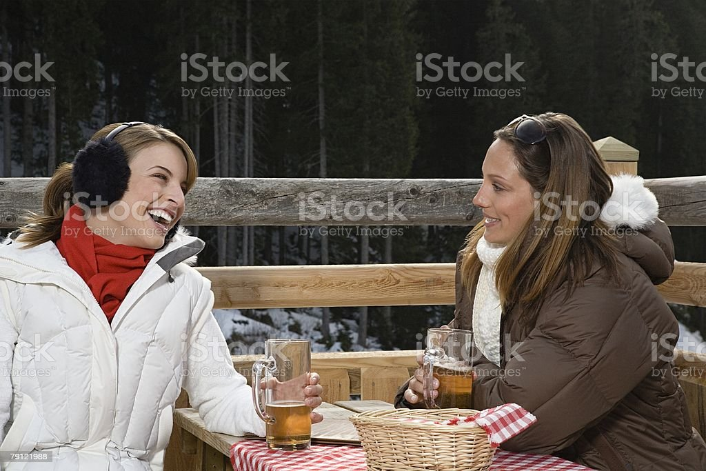 Friends having a beer royalty-free stock photo