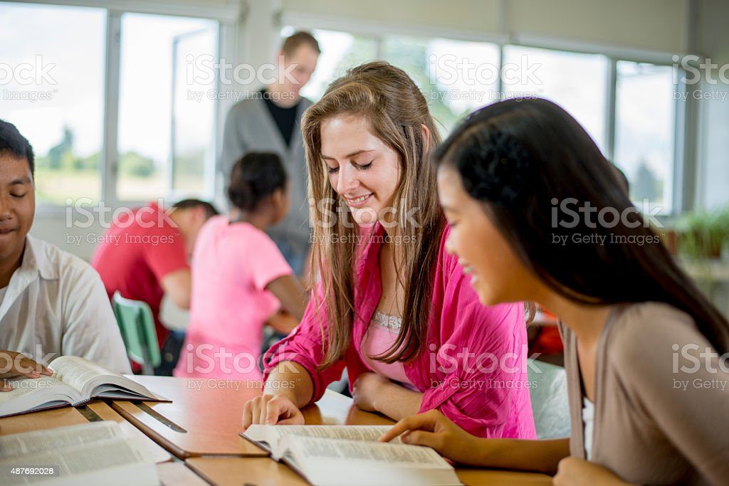 Friends Having a Bible Study Together stock photo