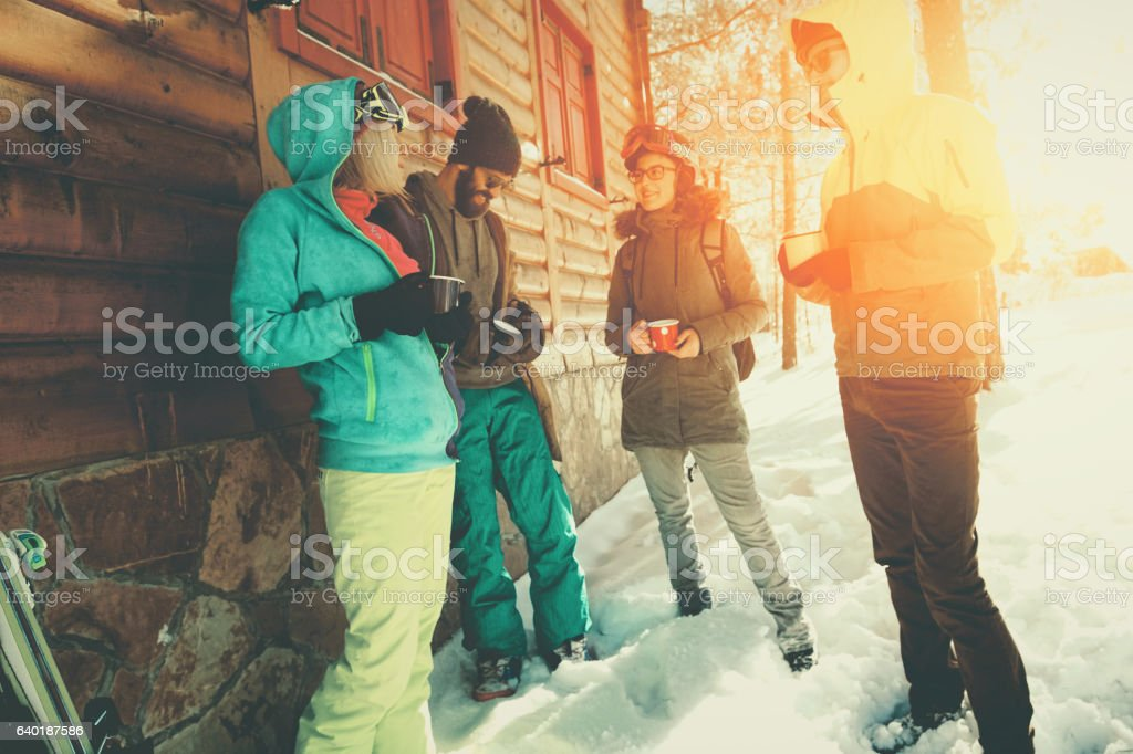 Friends having a break outside cotage stock photo