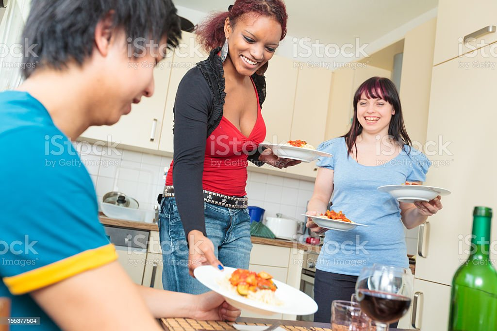 friends having a dinner party royalty-free stock photo