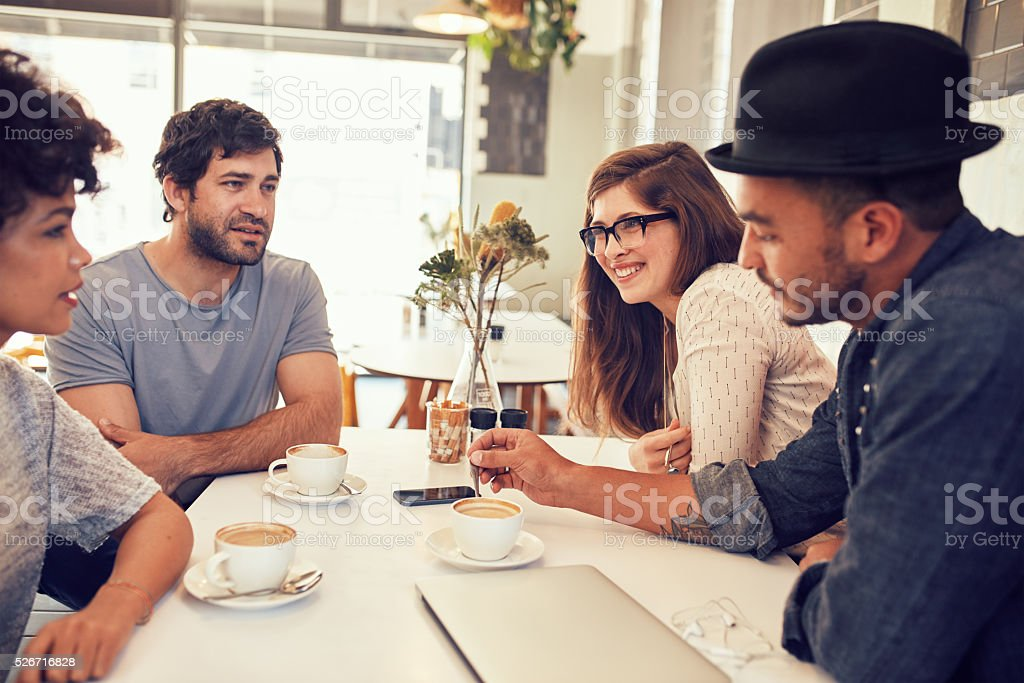 Friends having a discussion over a cup of coffee stock photo