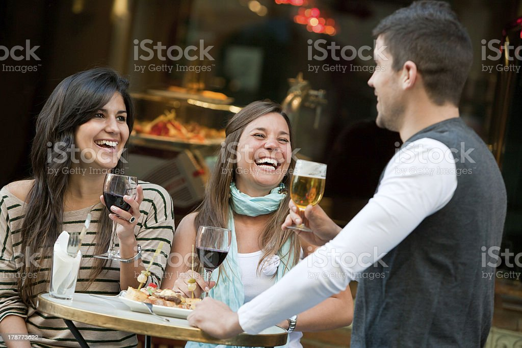 Friends having a drink. stock photo