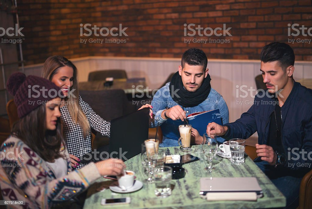 Friends having a great time in cafe stock photo