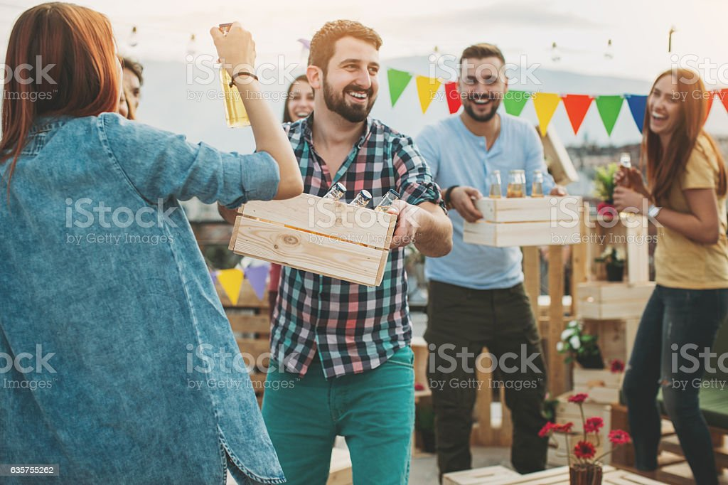 Friends having a party with beer stock photo