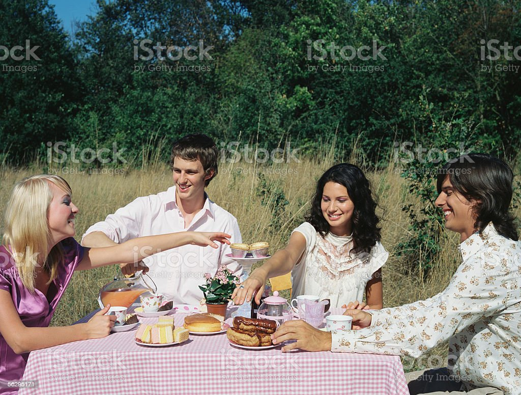 Friends having a tea party royalty-free stock photo