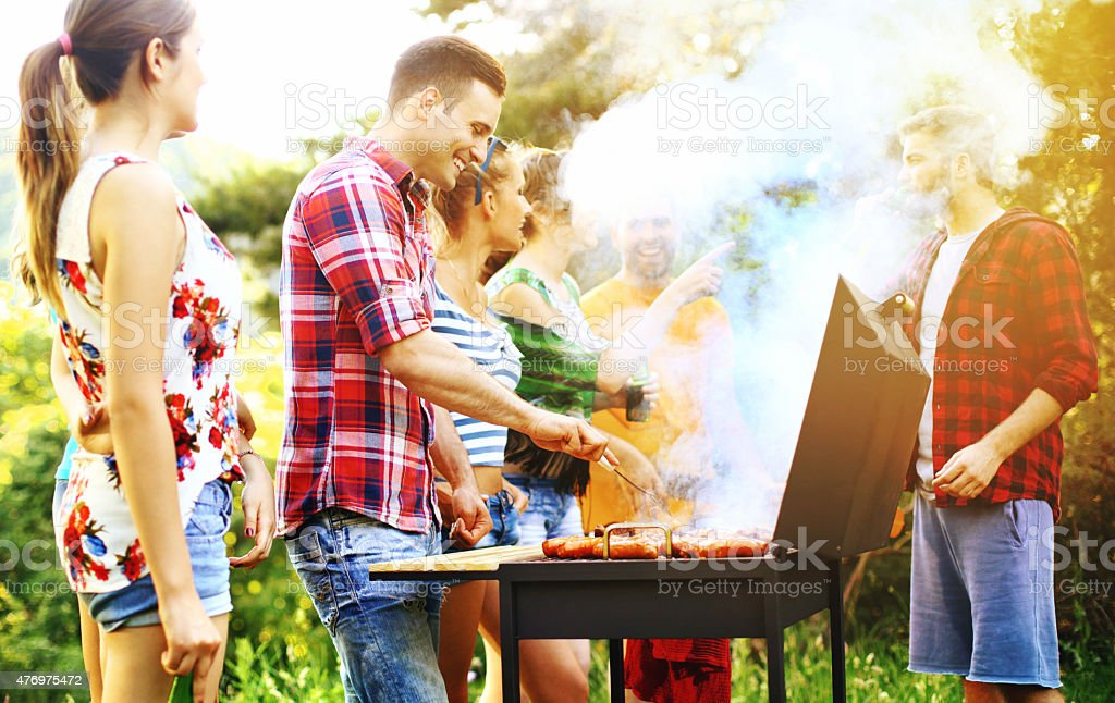Friends having barbecue party. stock photo