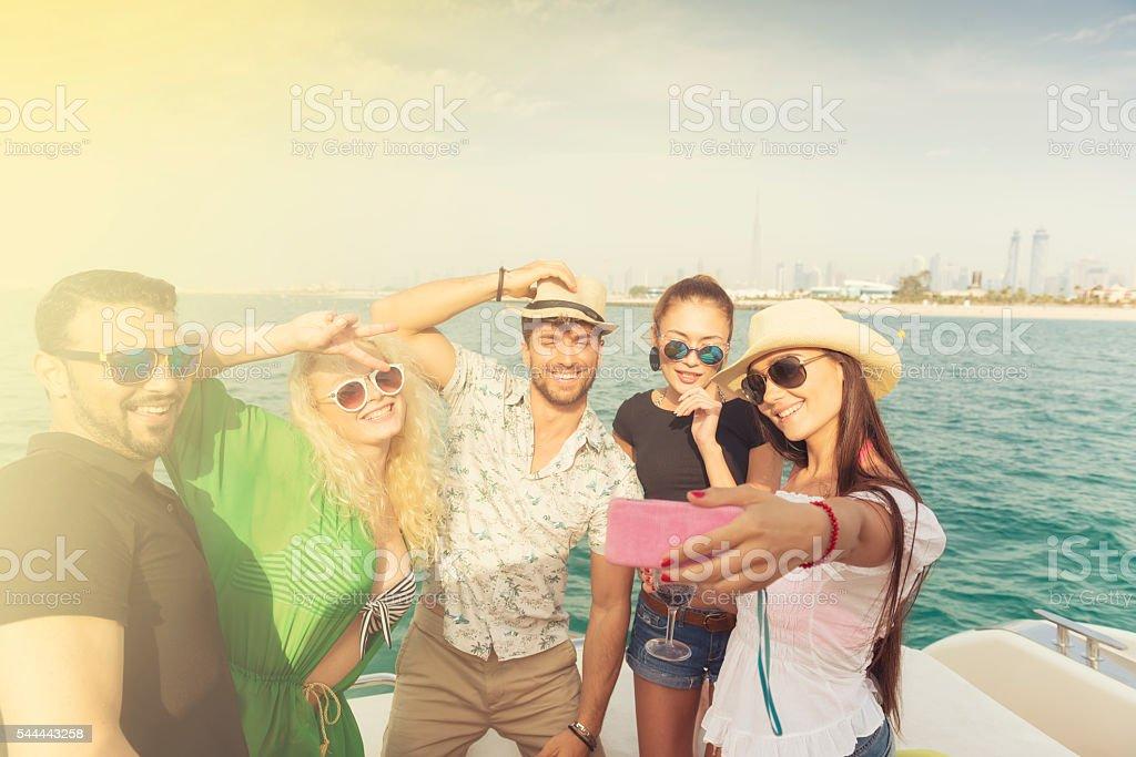 Friends having boat party in Dubai stock photo