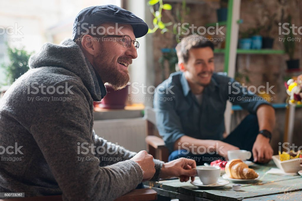 Friends having breakfast together stock photo