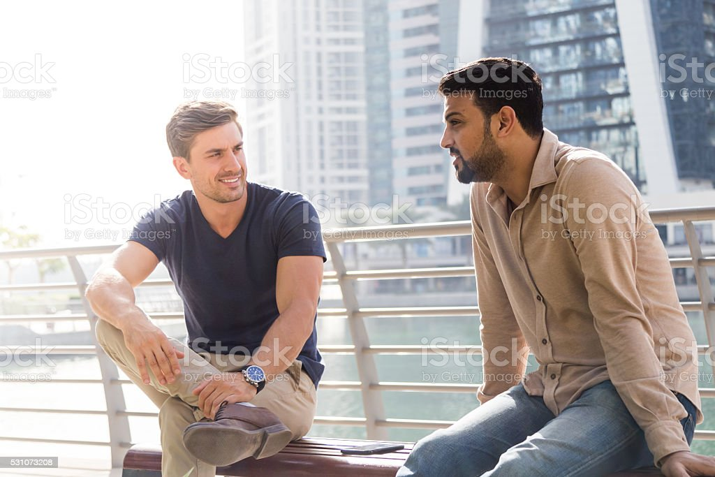 Friends having casual meeting outside office environment. stock photo