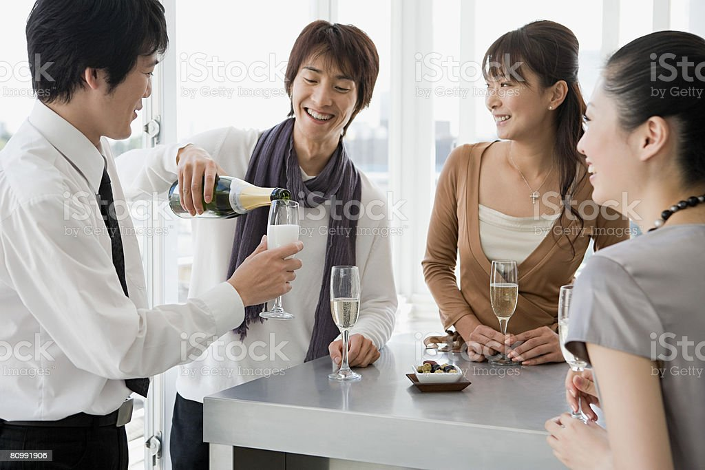 Friends having champagne royalty-free stock photo