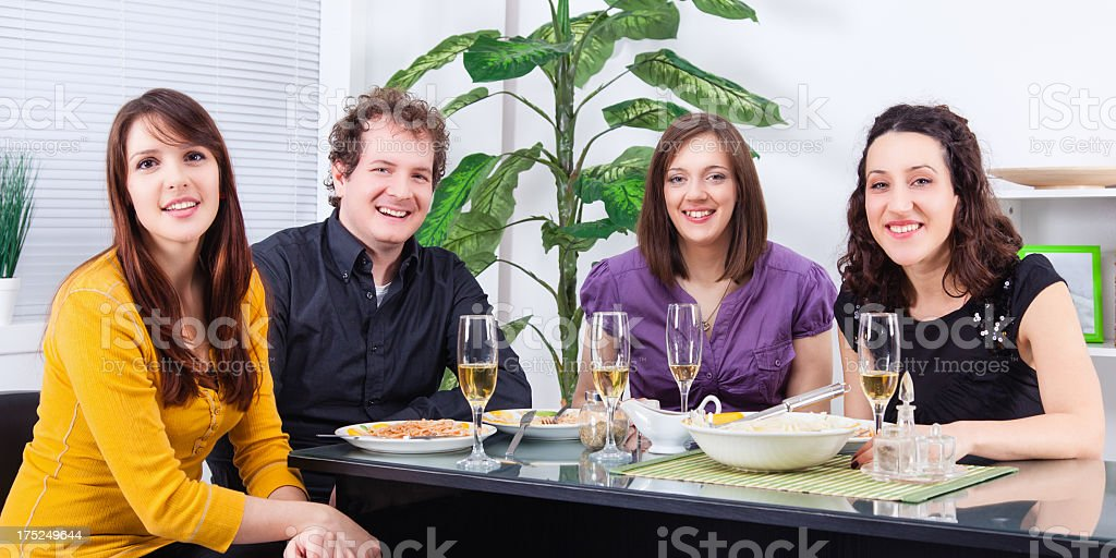 Friends having dinner at home royalty-free stock photo