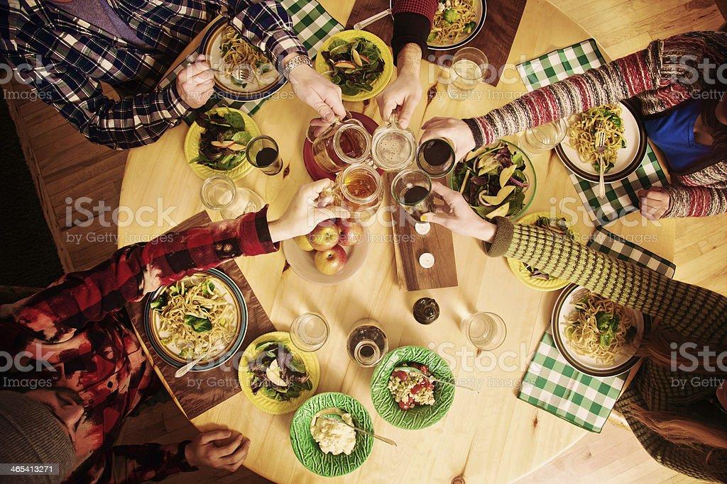 Friends Having Dinner in Cabin stock photo