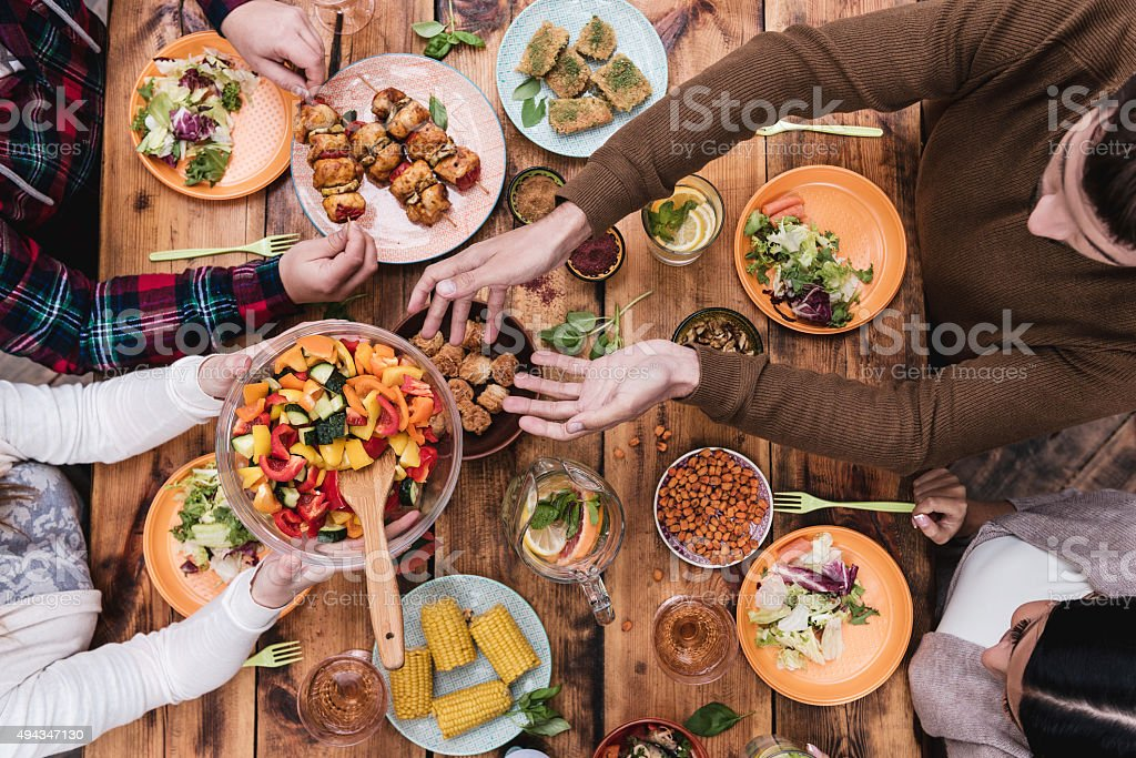 Friends having dinner. stock photo