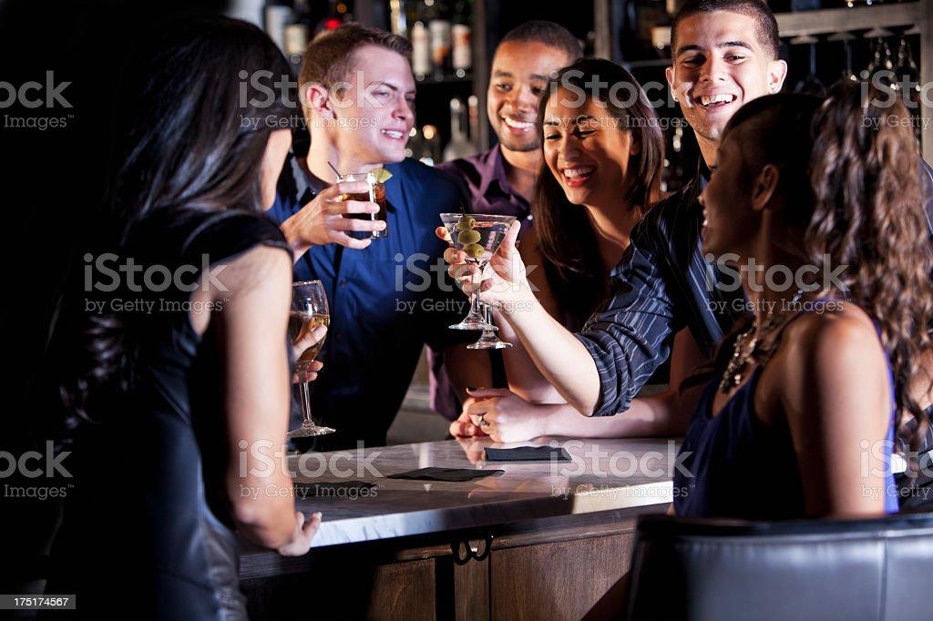 Friends having drinks at bar royalty-free stock photo