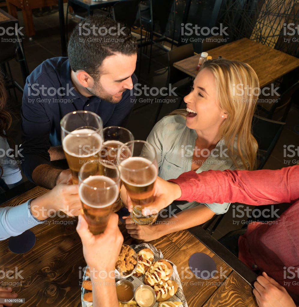 Friends having drinks at the bar stock photo