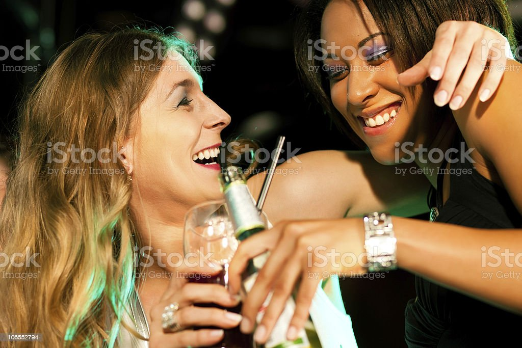 Friends having drinks in bar or club royalty-free stock photo