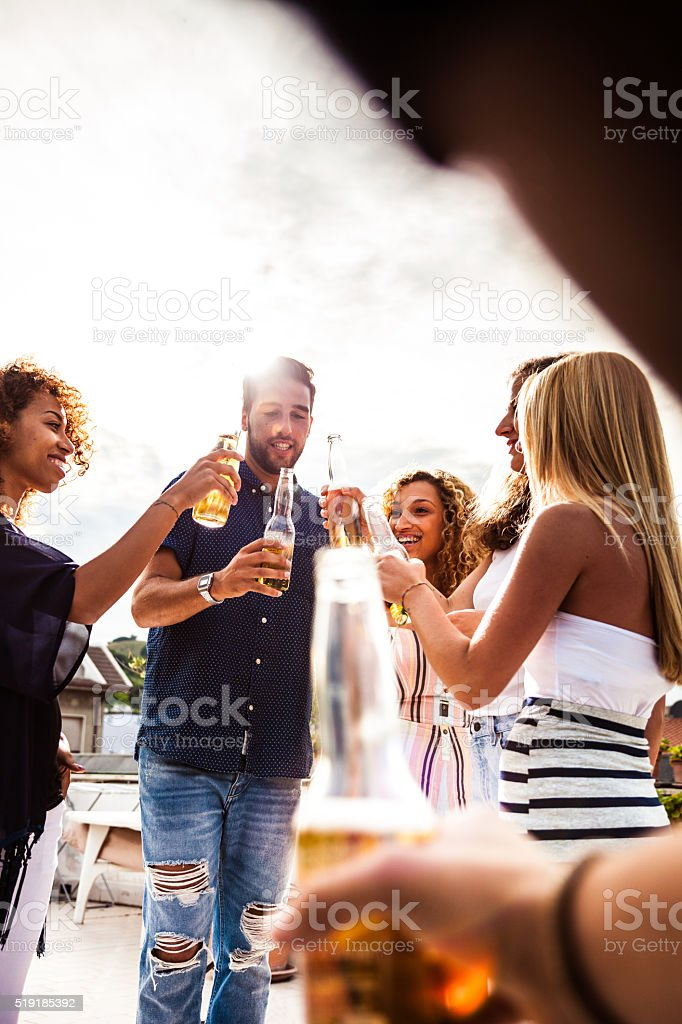 Friends having fun and drinking some beers outdoor stock photo