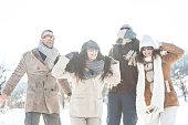 Friends having fun and enjoying the snow