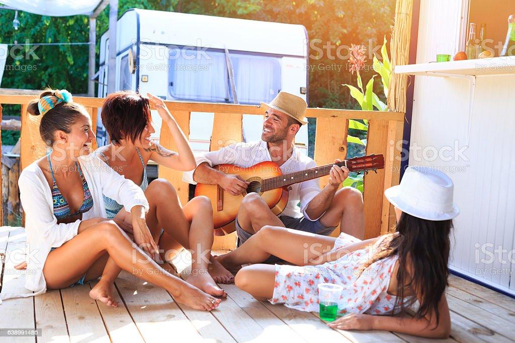 Friends having fun and flirting on sunny pavilion stock photo