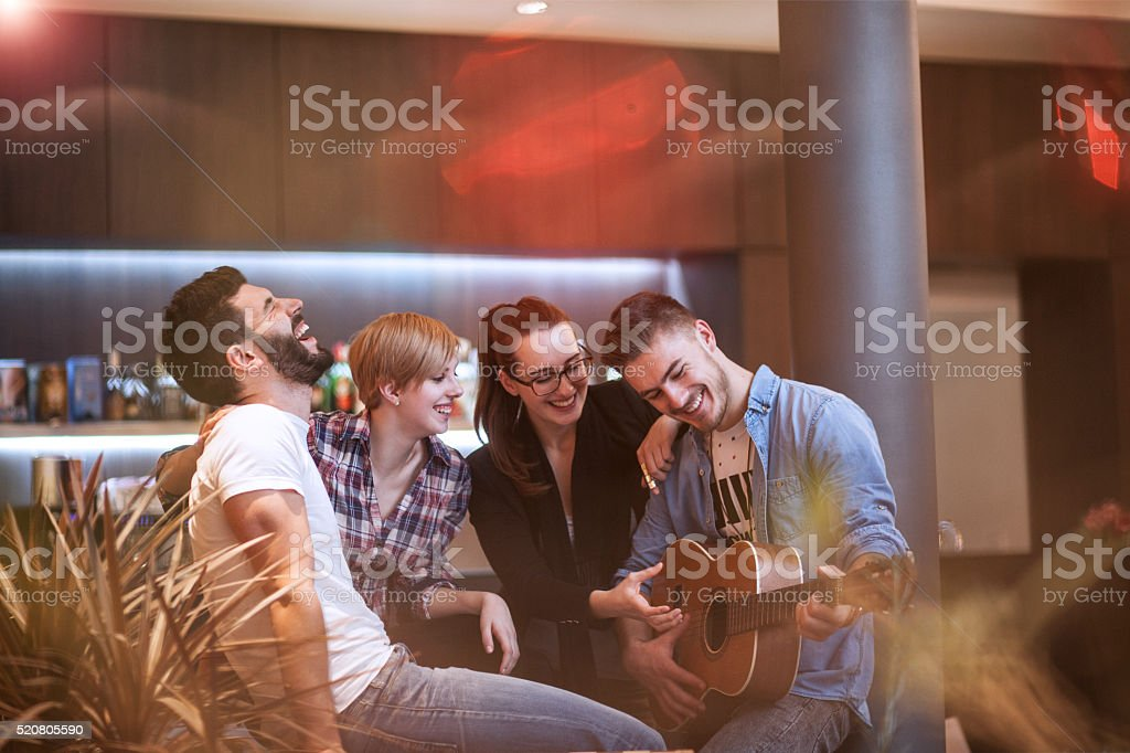 Friends having fun and relaxing evening stock photo