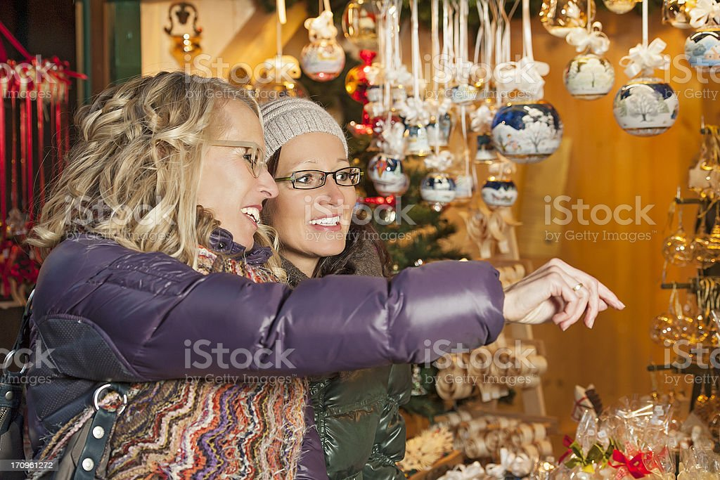 Friends having fun at a Christmas Market in Europe stock photo