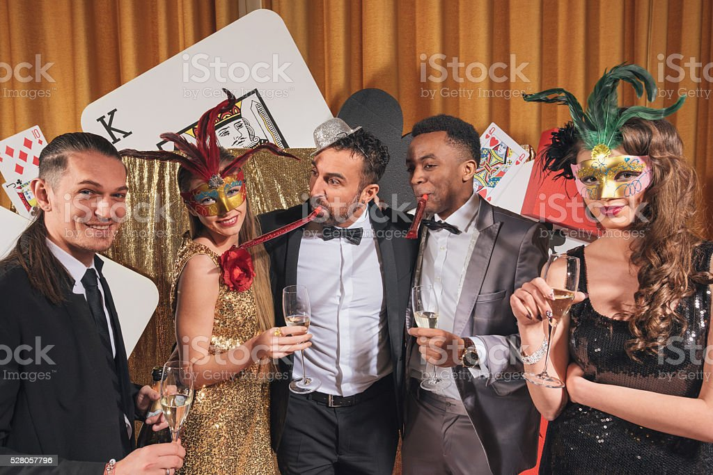 Friends having fun at a glamourous party stock photo
