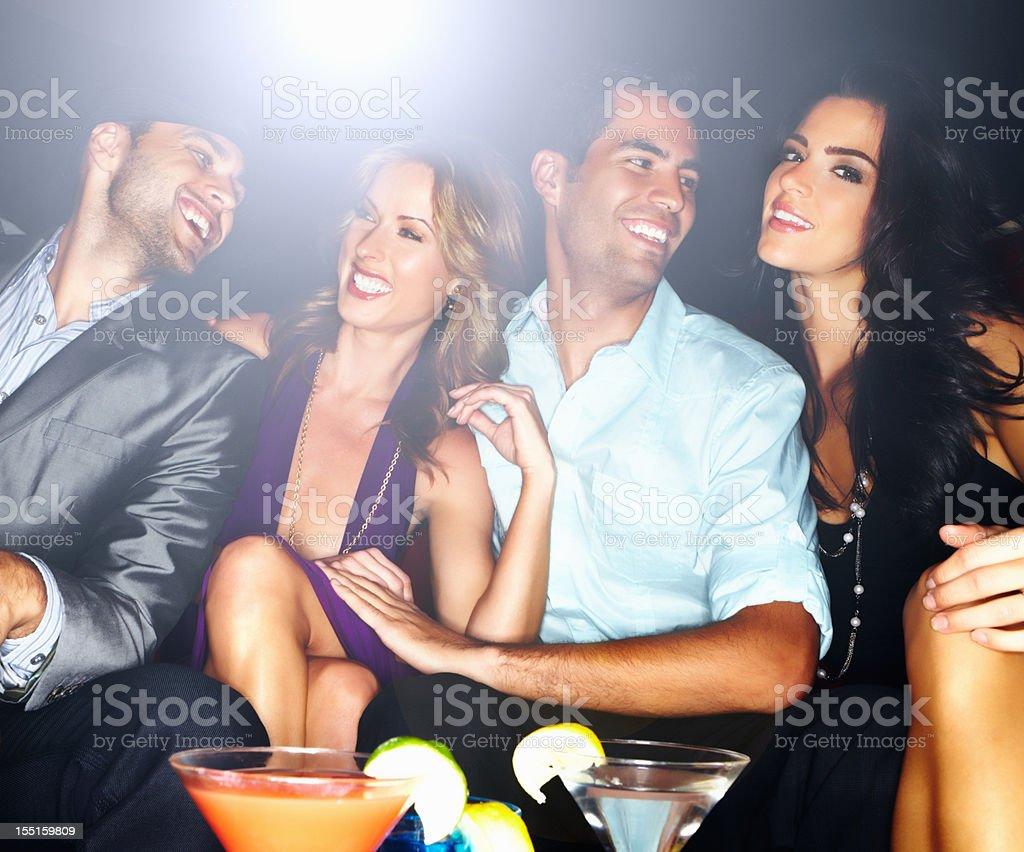 Friends having fun at a night club royalty-free stock photo