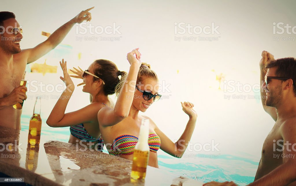 Friends having fun at beach bar. stock photo