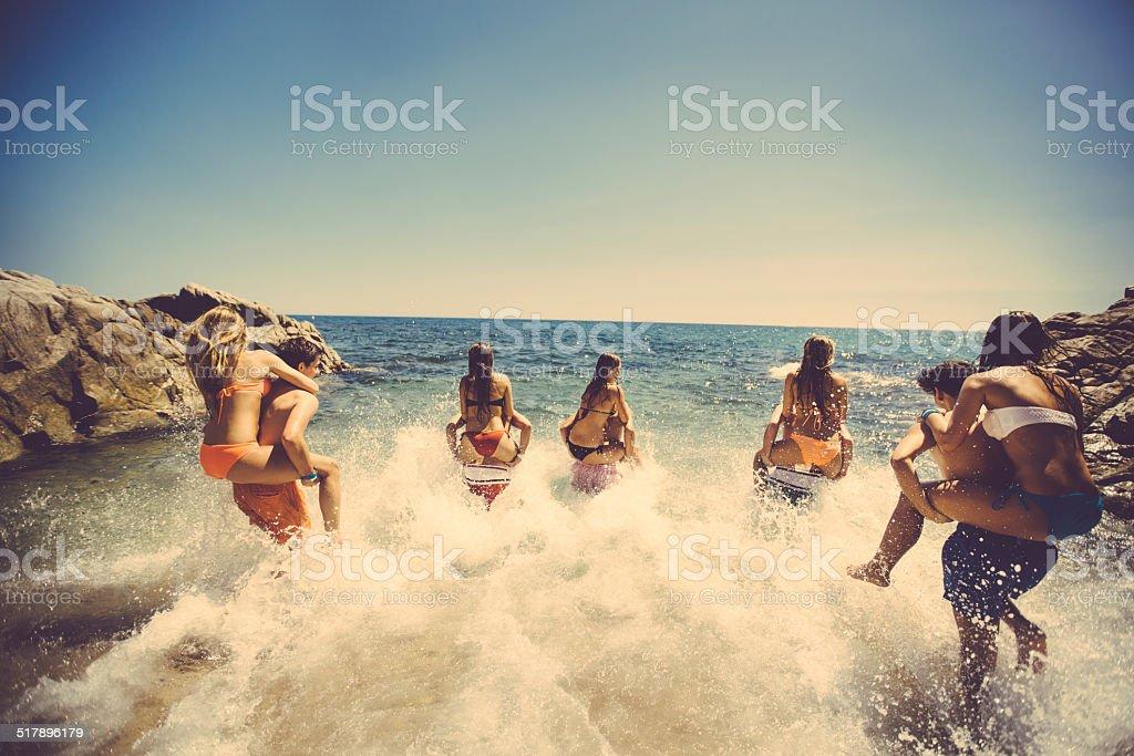 Friends Having Fun At Beach stock photo